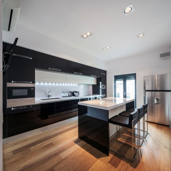 modern kitchen high gloss black cabinetry