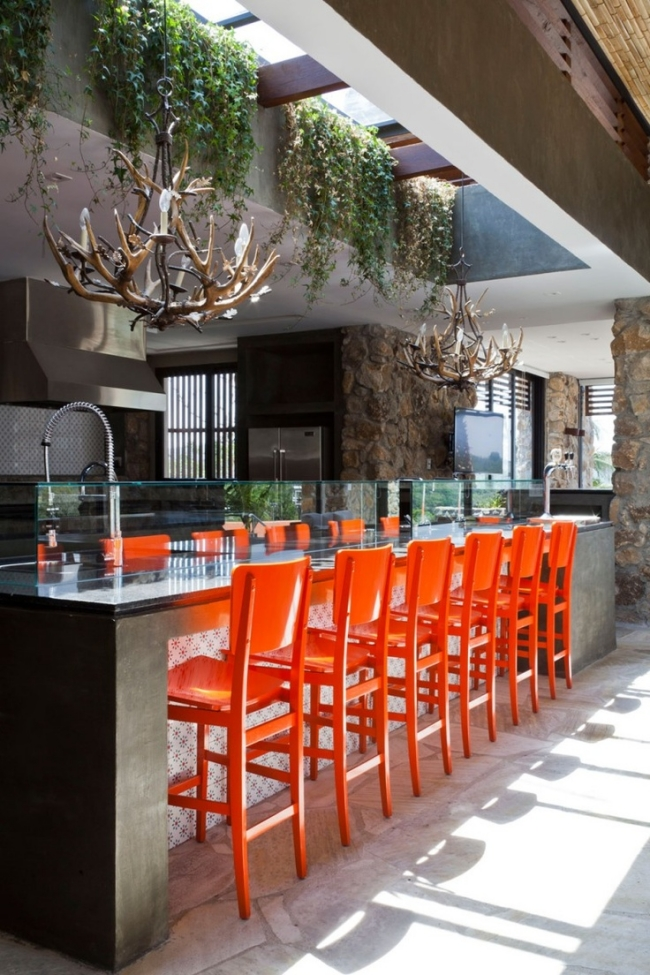 eclectic kitchen orange barstools chandelier