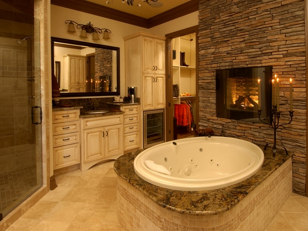 natural stone wall fireplace round tub
