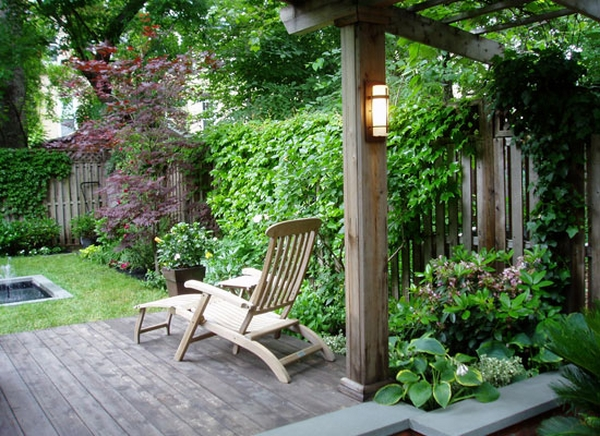 patio deck with grapevine arbor lounge chair backyard landscape