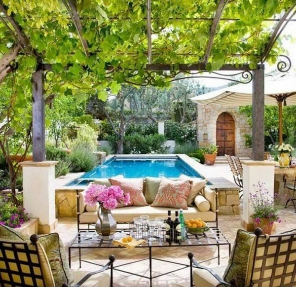 Mediterranean patio ideas grapevines outdoor wrought iron furniture