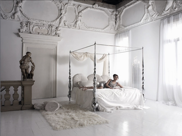 romantic bedroom with poster bed silver