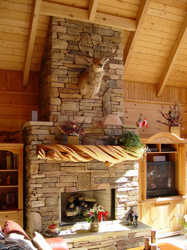 Rustic-fireplace-mantels-driftwood-mantel-natural-stone-surround