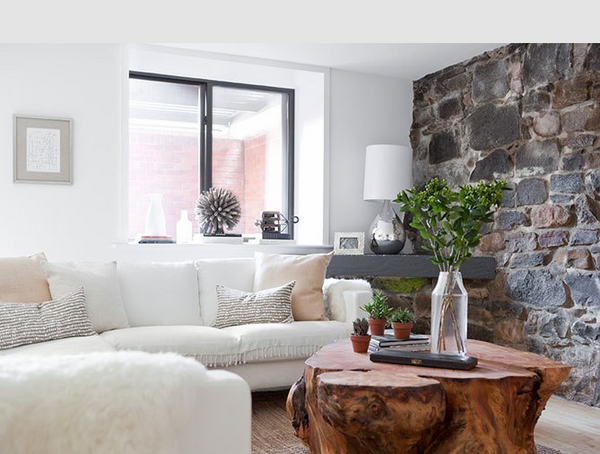 small living room ideas stone wall tree trunk coffee table