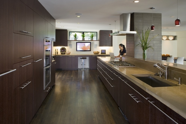 modern long concrete counter top dark wood cabinets