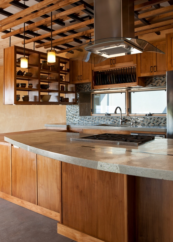 wood cabinets ceiling beams concrete countertop