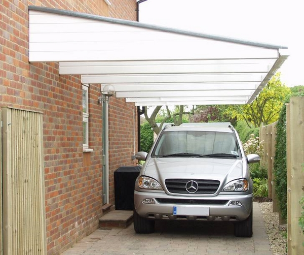 white carport cantilevered sheltering house extension