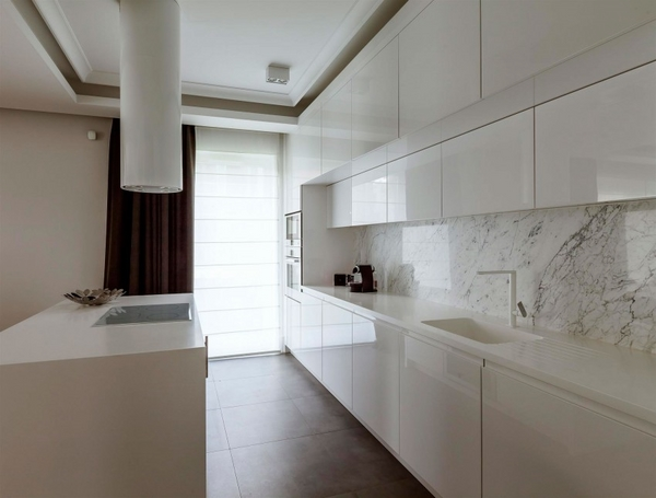 Modern minimalist style white kitchen with island