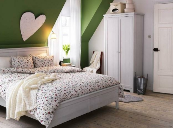 sloping ceiling Bedroom design attic ideas green accents white wall cabinet