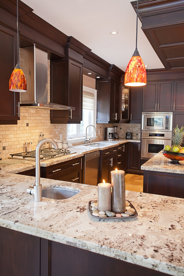 Giallo Ornamental granite countertops dark wood cabinets