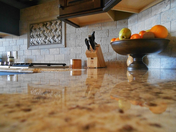 Giallo Ornamental granite countertop cherry wood cabinetry