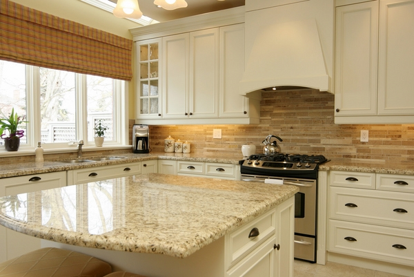 white kitchen Giallo Ornamental granite countertops white cabinets