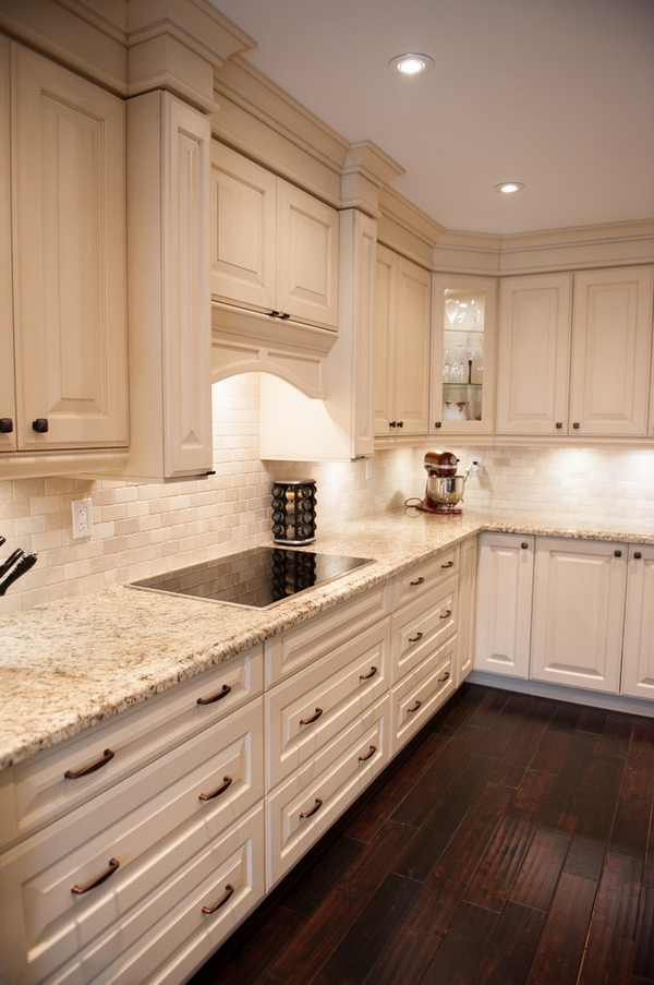 white-kitchen design Giallo Ornamental granite countertops white cabinets wood flooring