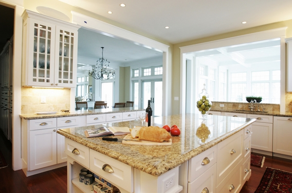 kitchen remodel ideas Giallo Ornamental granite countertops white cabinets wood-flooring