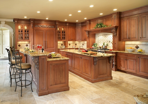 granite countertops wood cabinets travertine flooring