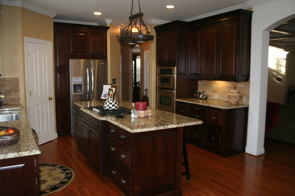 countertops dark wood kitchen cabinets wood flooring