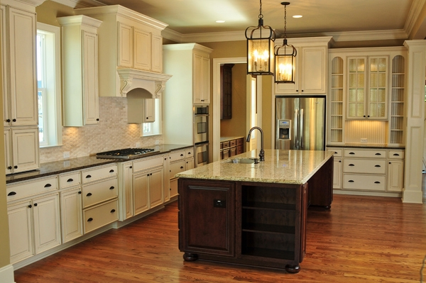contemporary countertop white cabinets wood flooring