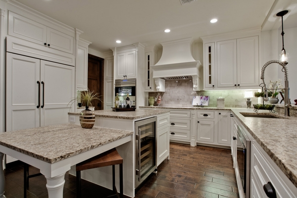 Mediterranean kitchen countertops white cabinets wood flooring