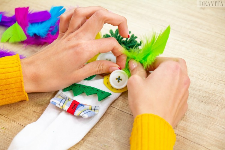 DIY crazy socks for kids glue colorful feathers