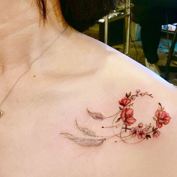 collarbone tattoo for women dreamcatcher and flowers