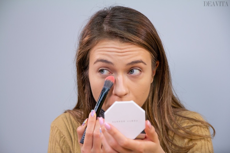Set the concealer with powder and a flat foundation brush