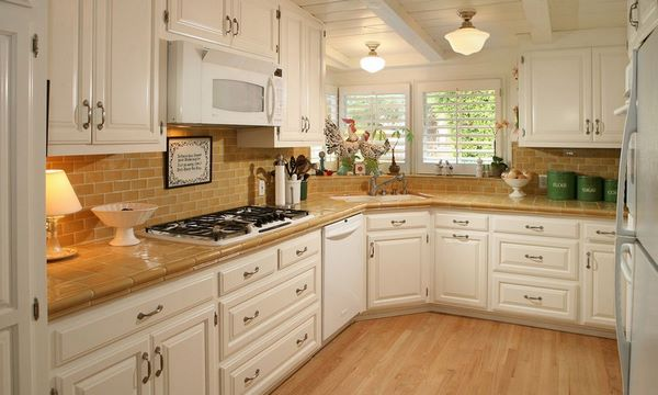 corner kitchen design white cabinets with tiles on countertop