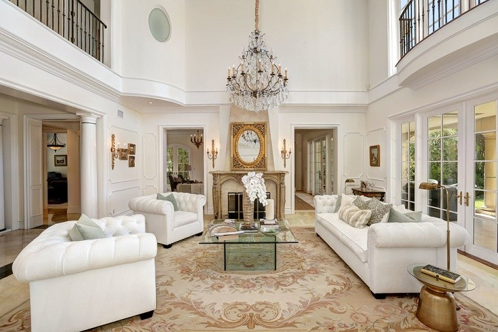traditional style formal room with glass coffee table sofa fireplace