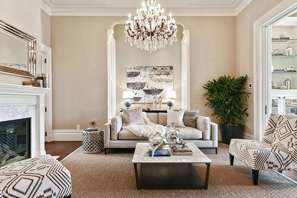 traditional style formal living room with chandelier and fireplace sofa armchairs