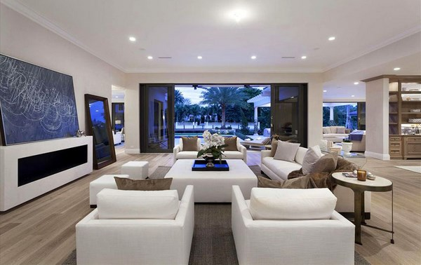 contemporary open plan formal living space with white furniture