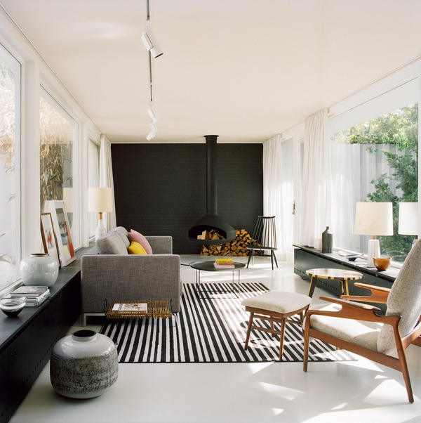 living room fireplace ideas suspended fireplaces freestanding fireplaces black accent wall