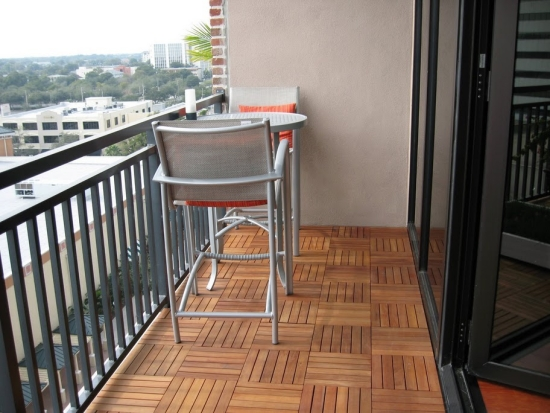 Balcony wooden tiles flooring metal table bar stool