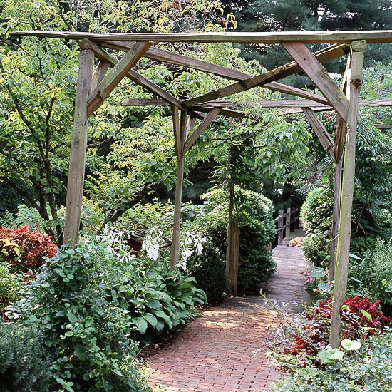 Rustic wooden pergola in the middle of the garden
