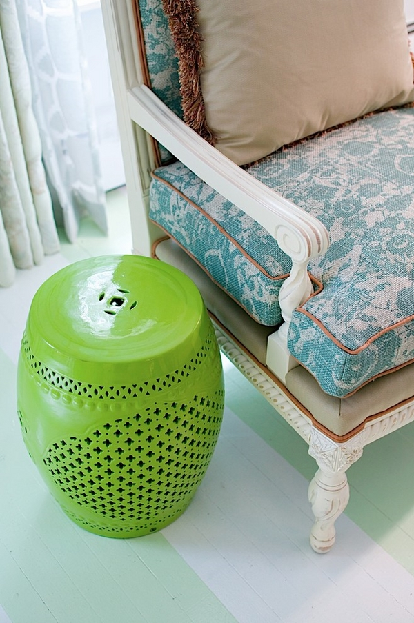 beautiful green ceramic stool as a side table