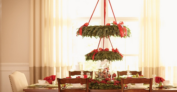 creative christmas decor ideas hanging wreaths chandelier red ribbons