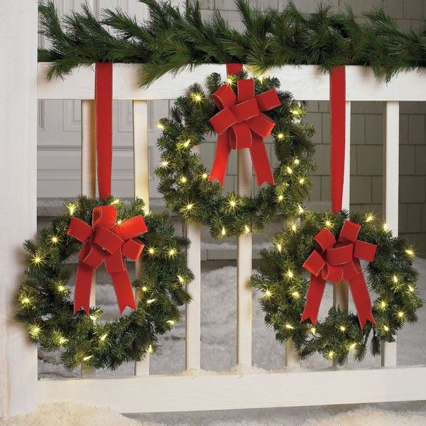 porch railing decorating ideas christmas wreaths with lights red bows