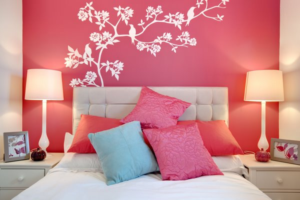positive colors for bedrooms red accent wall cream furniture