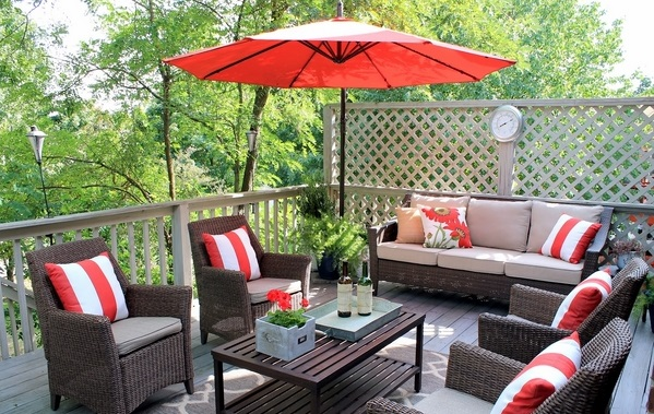 Rattan outdoor patio furniture cushions with red umbrella