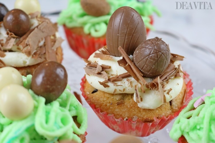 easter cupcakes with chocolate shavings and Easter eggs