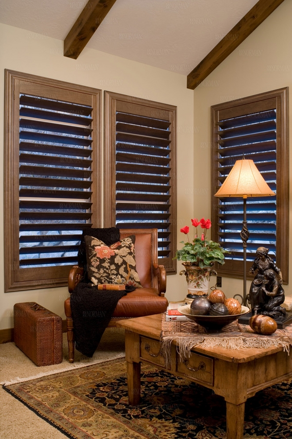 Family room plantation window shutters rustic table