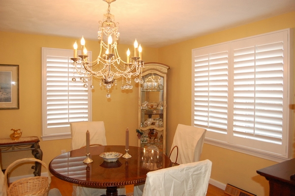 White wood plantation shutters in dining room design