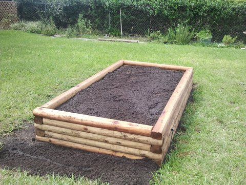 how to build a raised garden bed construction tips