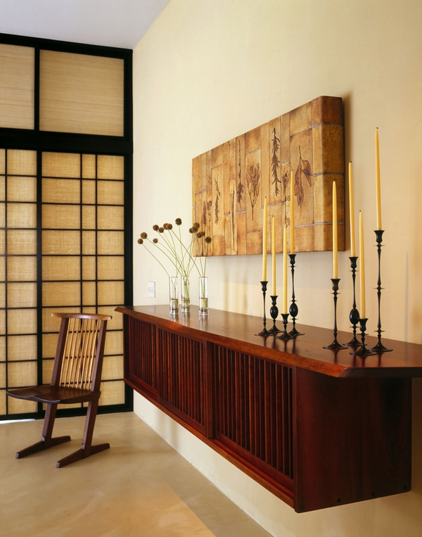 hallway-floating-credenza-cabinet dark wood candle holders wall art