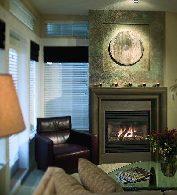Contemporary-fireplace-surround-ideas earthy colors metal decoration